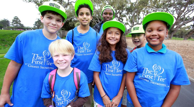 Smiling kids in The First Tee Sacremento t-shirts