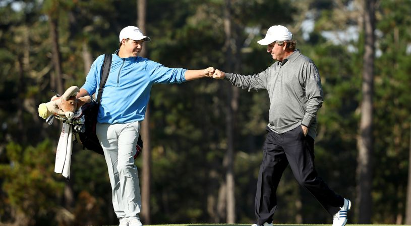 PEBBLE BEACH, CA - SEPTEMBER 17: Gene Sauers fist bumps Maxwell Turnquist after they finished the 10th hole during Round Two of the Nature Valley First Tee Open at Poppy Hills Golf Course on September 17, 2016 in Pebble Beach, California. (Photo by Ezra Shaw/Getty Images)